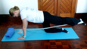 Runner's Pilates exercise. Use a theraband to work on your glutes.