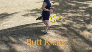Butt Kicks: dynamic stretching before running