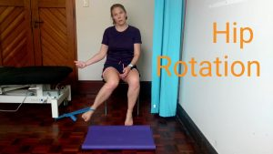 hip flexibility exercises for runners: Hip rotation using a theraband.
