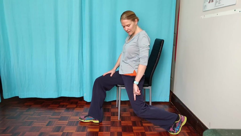 A hip flexor stretch is one of the stretches to do at your desk. You'll need one of your legs off the side of the chair. Aim for a stretch at the front of your thigh.