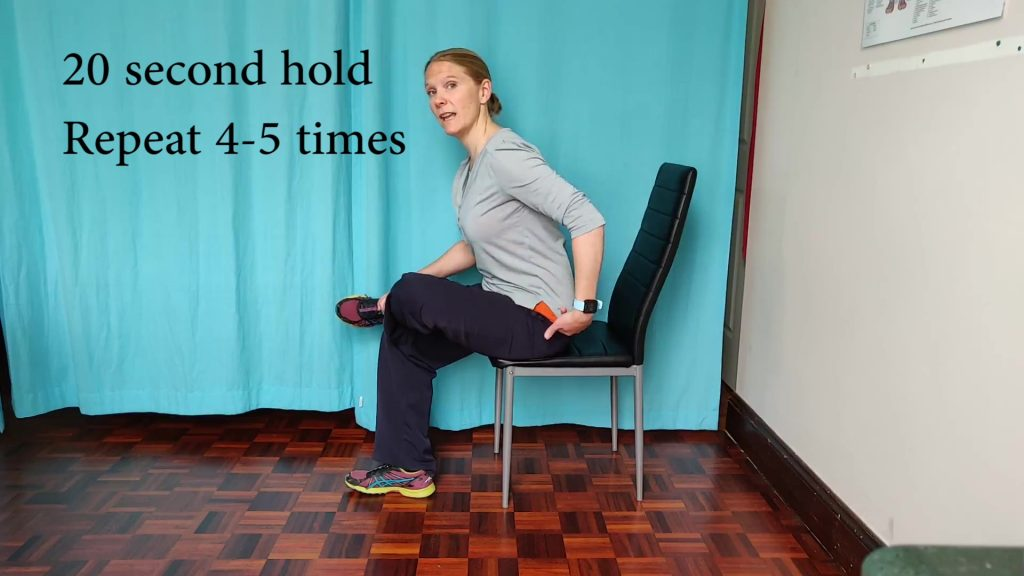 Glutes is the third stretch to try at your desk. Sit upright, put your right foot onto your left knee and look for a stretch in the right glutes.