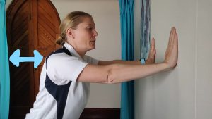 How to Improve Shoulder Strength for Desk Workers - inclined on a wall.