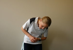 Best Exercises for a Tight Lower Back using a Massage Ball: Squash Against the Wall & Combine Movements