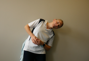 Best Exercises for a Tight Lower Back using a Massage Ball: Squash Against the Wall & Lean Sideways