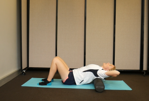 How to Ease Back Tension with a Foam Roller: Lay on it Horizontally