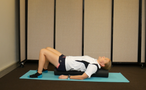 How to Ease Back Tension with a Foam Roller: Lay on it Lengthwise