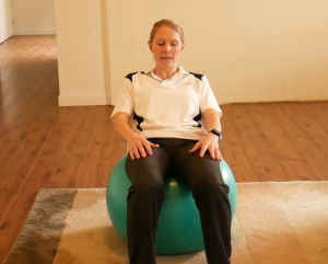 3 Abs Exercises on a Gym Ball (swiss or fit ball) to Try Out/ Exercise #1: Roll down
